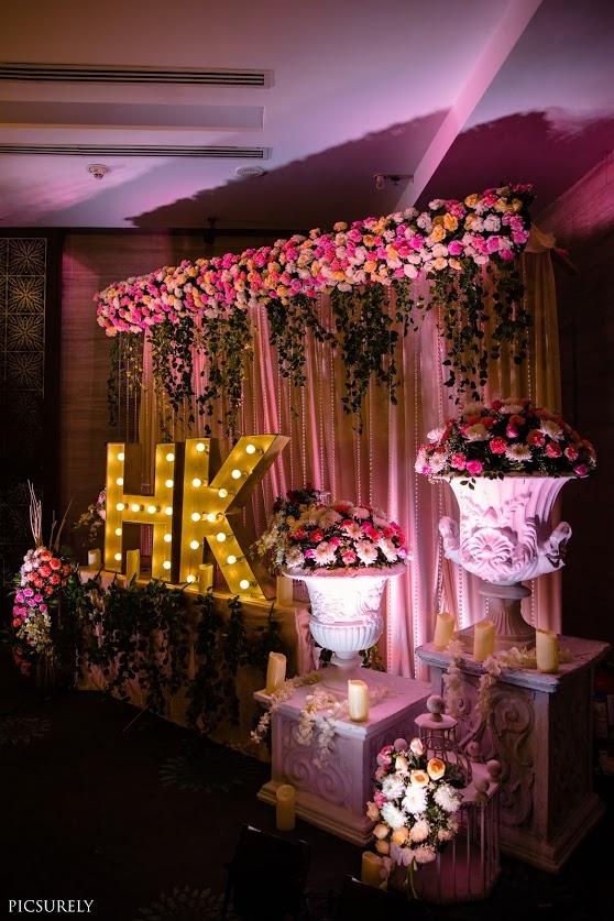 Beautiful Photo Booth decor at this Reception Party at JW Marriott Mumbai post Sea Princess Juhu Wedding