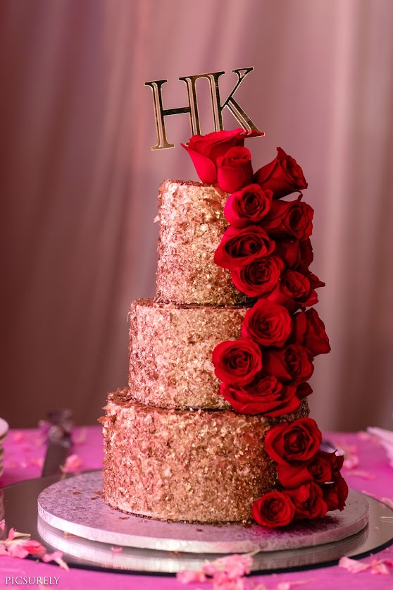 Delicious Red & Gold Wedding Theme Cake at the reception party of this beach wedding in Mumbai