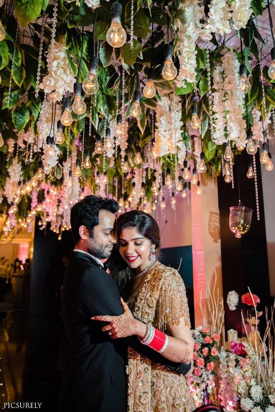 Harsha & Kunal's beautiful picture with pastel themed reception decor done at JW Marriott Juhu Mumbai