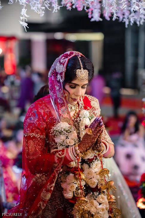 Candid Picture of Harsha post her Sea Princess Juhu Wedding's Varamala Ceremony