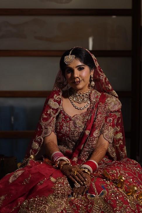Harsha adorned in a stunning red Rimple and Harpreet Narula bridal lehenga for her Sea Princesss Juhu Wedding