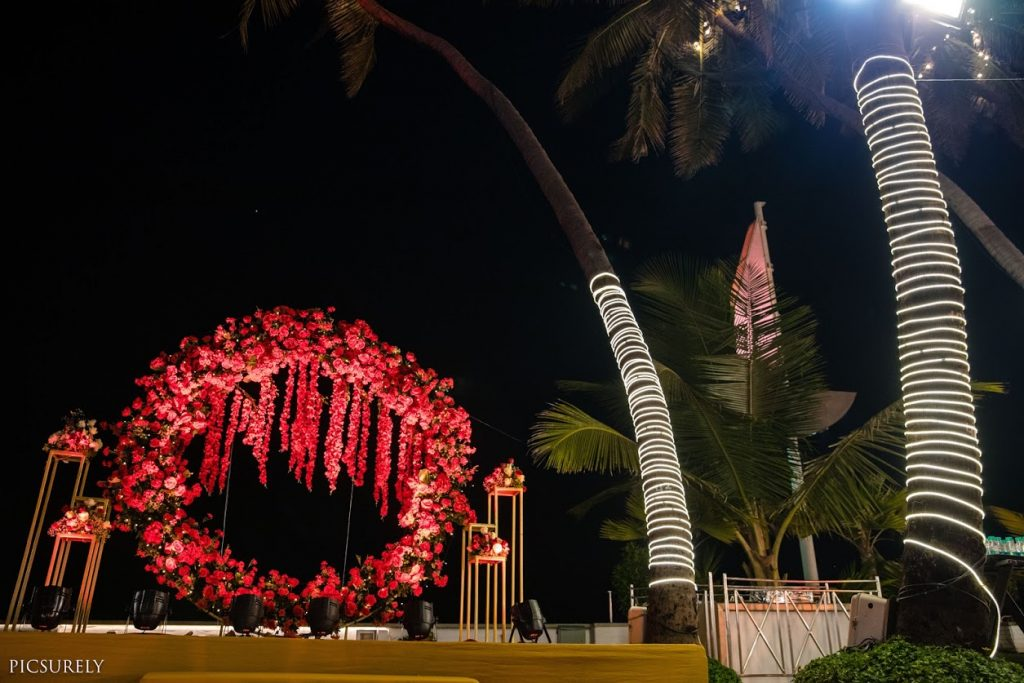 Beautiful Red and Golden Floral Decor for Open Air Wedding at Sea Princess Beach Resort