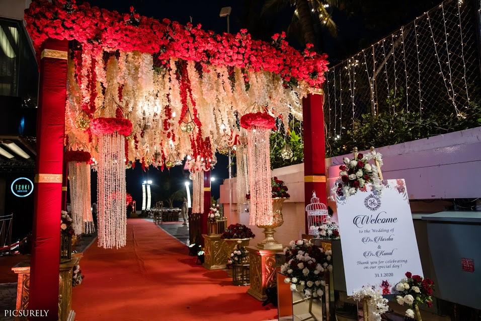 Red Gold Wedding Theme Entrance Decor for this Sea Princess Juhu Wedding