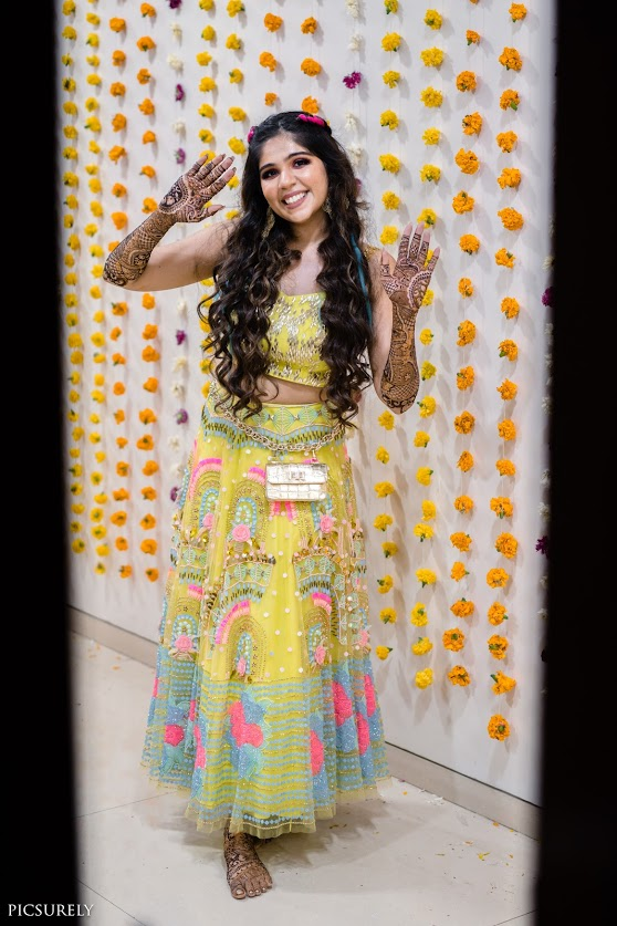 Harsha glowing in her colourful Mehendi outfit by Papa don't preach for her Sea Princess Juhu Wedding