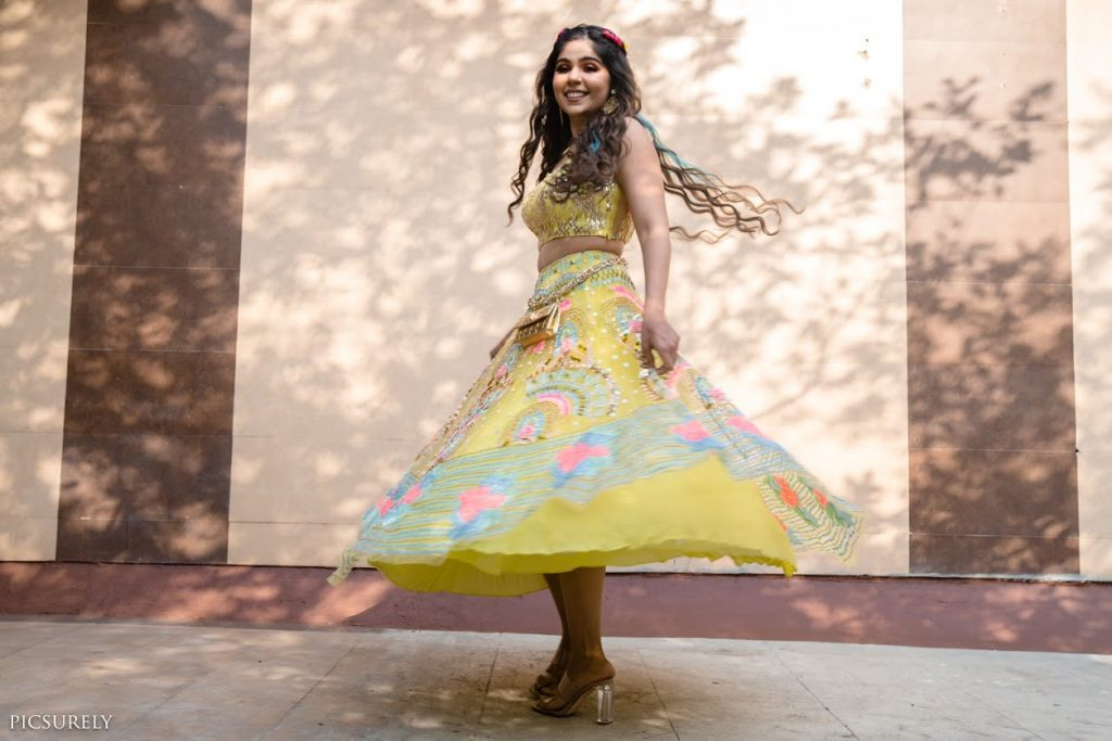 Gorgeous Portrait of Harsha in a colourful Mehendi outfit by Papa don't preach for her Intimate Mehendi Function at home