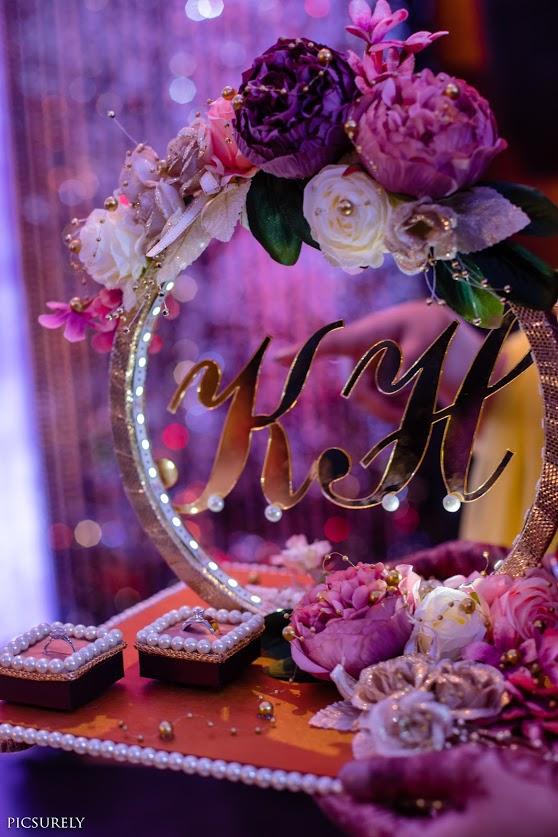 Beautiful Ring Platter Decor with Customised logo design for Harsha & Kunal's Sea Princess Juhu Wedding