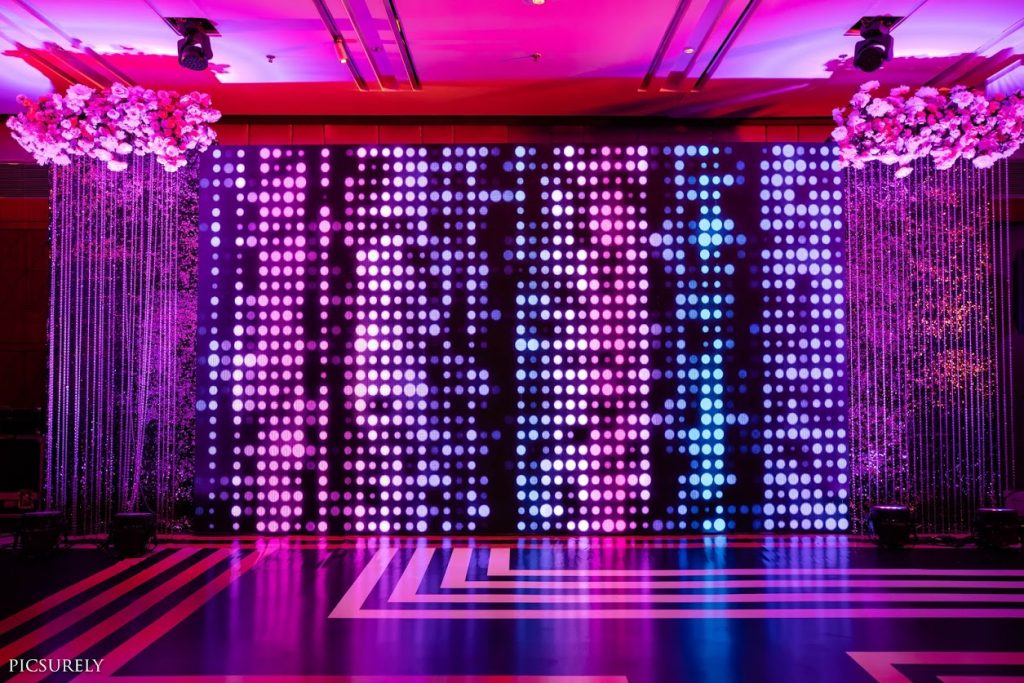 Amazing Dance Floor Decor done by National Decorators for this Sea Princess Juhu Wedding's Sangeet Ceremony