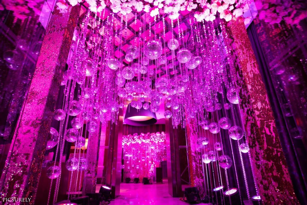 Stunning Decor with Disco balls and LED lights for Bling Themed Sangeet Ceremony at Hotel JW Marriott Mumbai