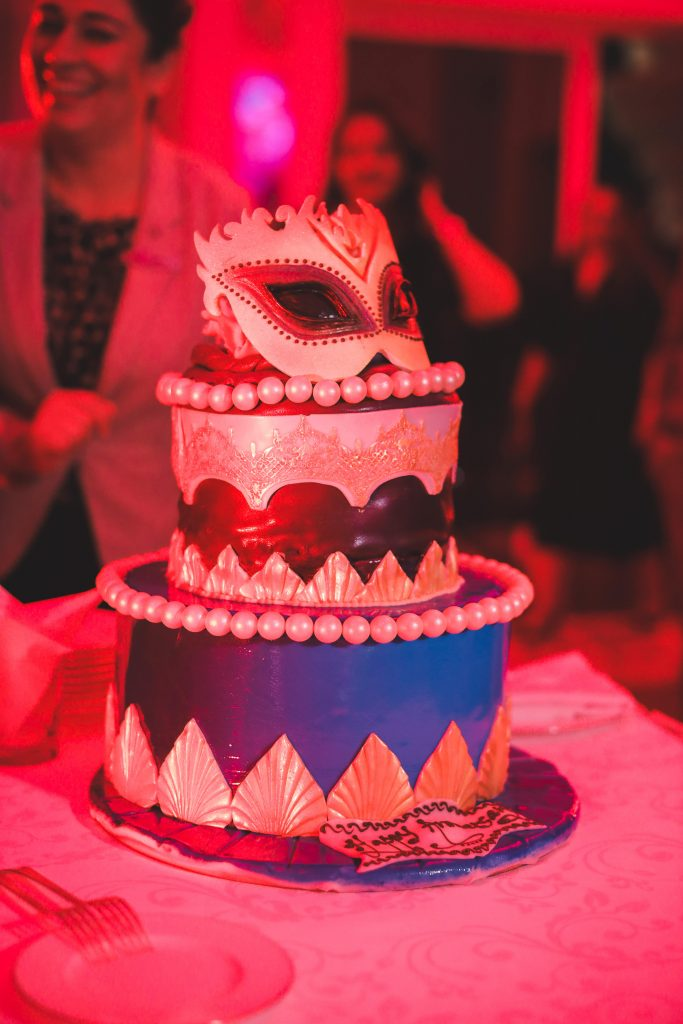 Masquerade-Themed Wedding Cake at Dubai Destination Wedding Welcome Dinner