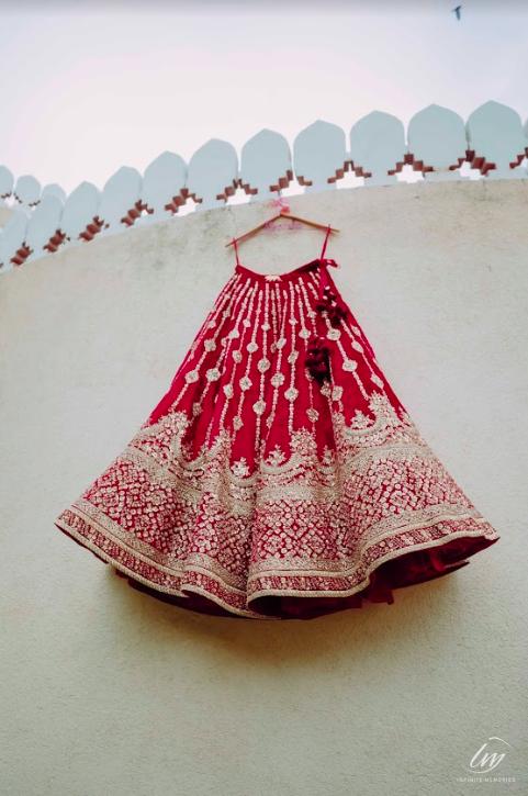 Gorgeous Red Sabyasachi Bridal Lehenga for Akansha's Royal Marwari Wedding at the Gulmohar Jaipur