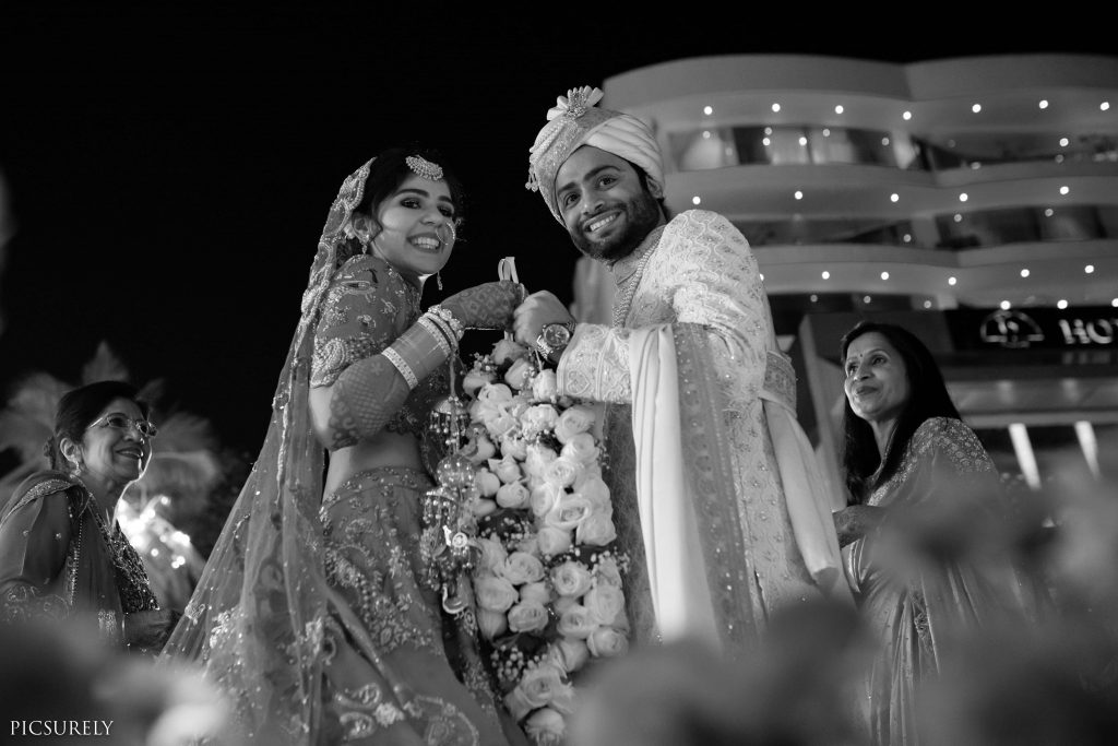 Harsha & Kunal's happy portrait pictures in the varmala ceremony of their Sea Princess Juhu Wedding
