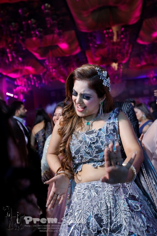 Energetic Bride dancing her heart out at her Cocktail Gala at Hotel Udman Delhi