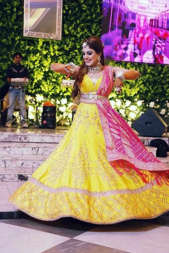 Gargi looking stunning in her gorgeous yellow Aditi Gupta lehenga for her Ritz Gurgaon Wedding's Mehendi Function