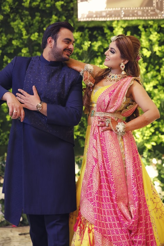 Get Quirky Wedding Couple Pose Ideas from this beautiful Ritz Gurgaon Wedding
