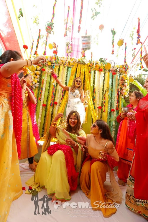 Haldi Floral Backdrop Decor at this Haldi Party of Ritz Gurgaon Wedding