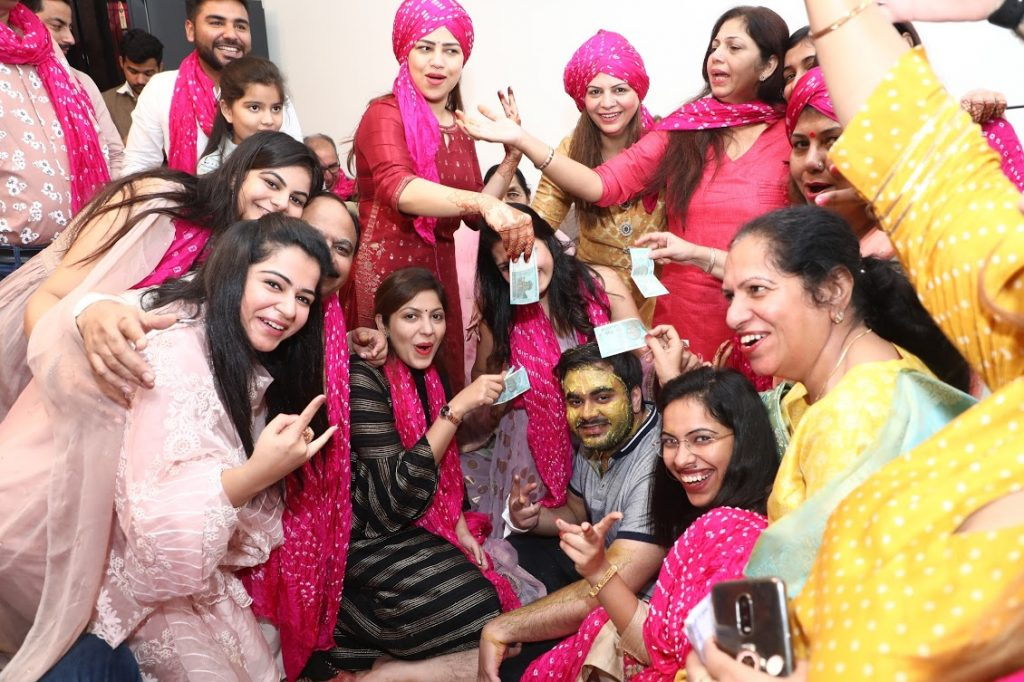 Unique Haldi with groom's family in Pagdis