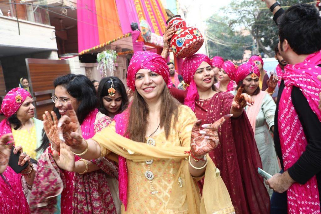 Groom Side Haldi Dancing Candids captured at this Ritz Gurgaon Wedding