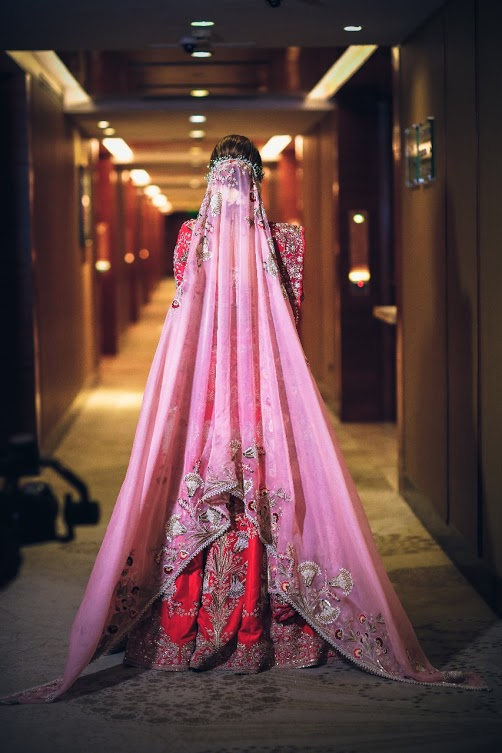 Unique Indian Bridal Outfit for Gargi consisting of Red Bridal Lehnega with beautiful pink dupatta pinned in the back