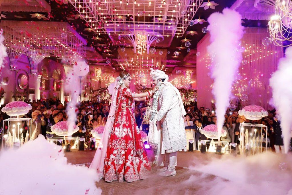 Candid Varmala Ceremony Portrait of Gargi & Saurabh from their grand Ritz Gurgaon Wedding in Delhi