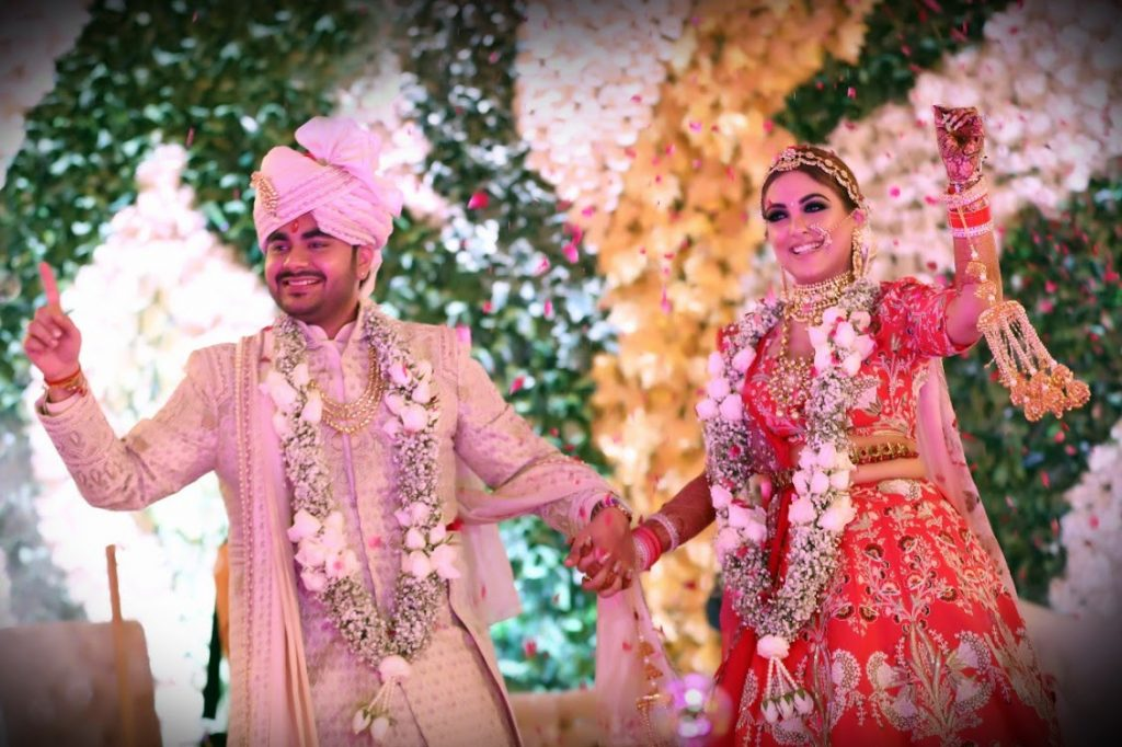 Ritz Gurgaon Wedding candid portraits captured with stunning floral stage backdrop
