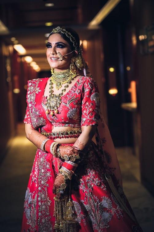 Beautiful Bride Gargi adorned in unique bridal jewellery set by Ra Abta by Rahul for her Ritz Gurgaon Wedding