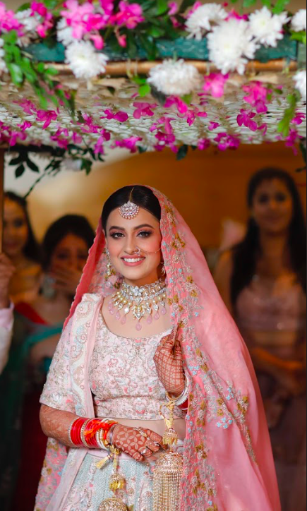 Gorgeous Still of Nishtha captured from her lovely bridal entry under Phoolon Ki Chadar at her Crowne Plaza Gurgaon Wedding