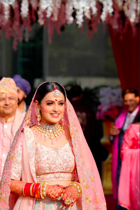 Candid Bridal Portraits of Nishtha from her luxury wedding in Delhi at Crowne Plaza, Gurgaon