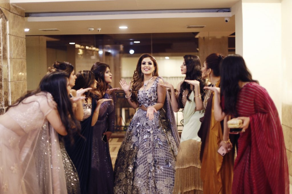 Bride Gargi posing with her bridesmaids on the cocktail ceremony of her Ritz Gurgaon Wedding