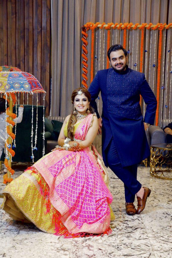 Gargi & Saurabh posing for a picture in the mehendi ceremony of their Ritz Gurgaon Wedding