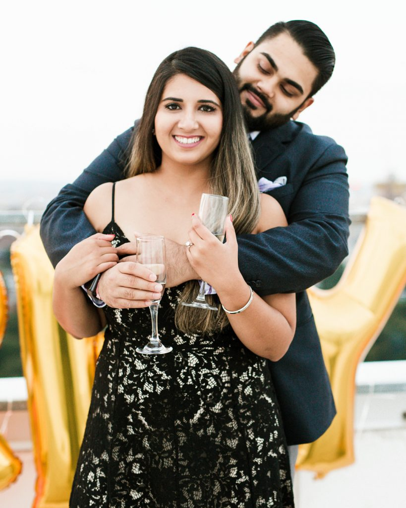 Cute portrait shot of Vrunda & Sunny at W Boston for a surprise wedding proposal from Sunny