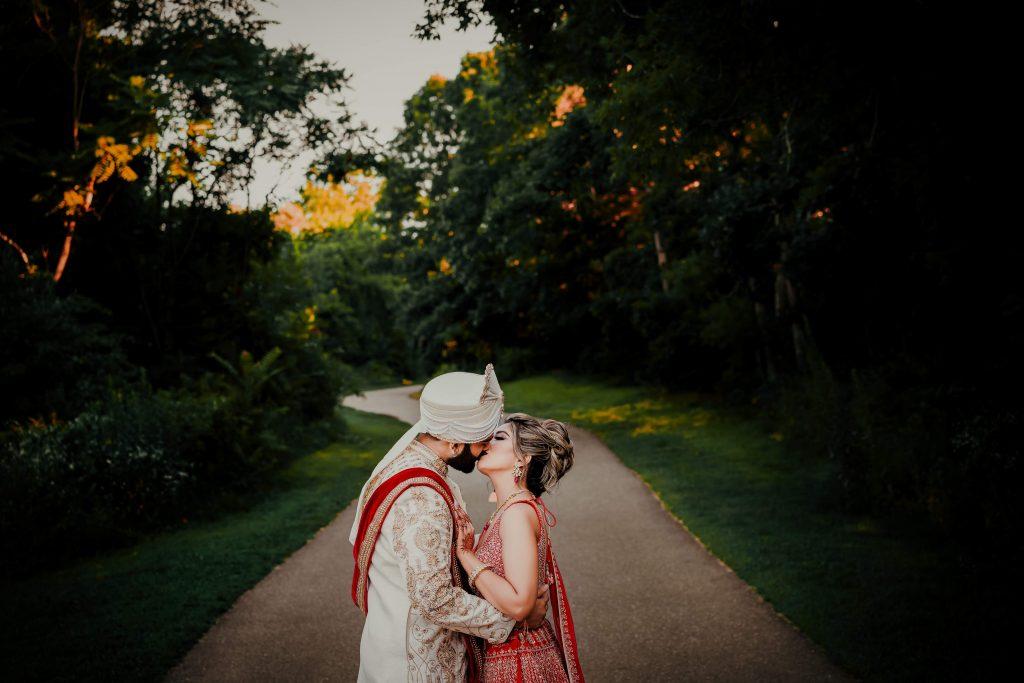 Vrunda & Sunny's romantic kissing picture portrait