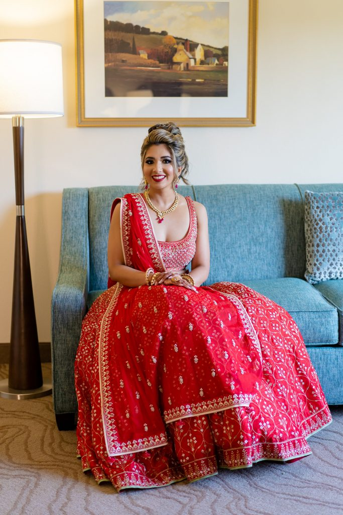 Beautiful Bridal Solo of Vrunda in Red Anita Dongre lehenga, messy high bun & glam makeup look with bold red lips