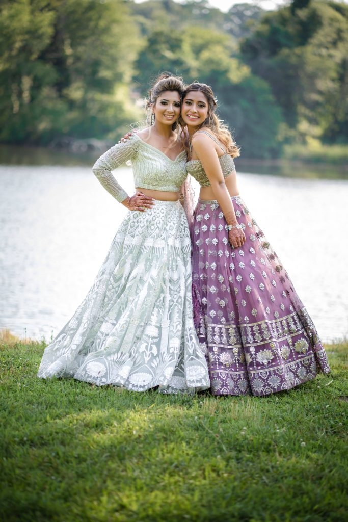 A cute portrait of Vrunda with her sister on the reception ceremony of Vrunda & Sunny's Forest themed wedding in Boston