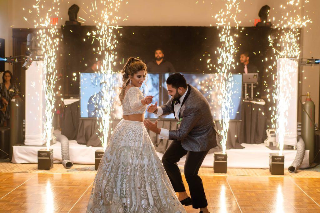 Vrunda & Sunny dancing amidst fireworks at their indoor forest themed wedding reception at Doubletree by Hilton, Boston