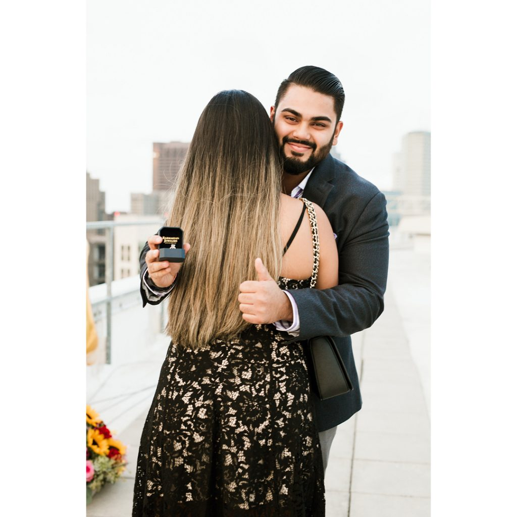 Vrunda & Sunny cute picture at W Boston for a surprise rooftop proposal