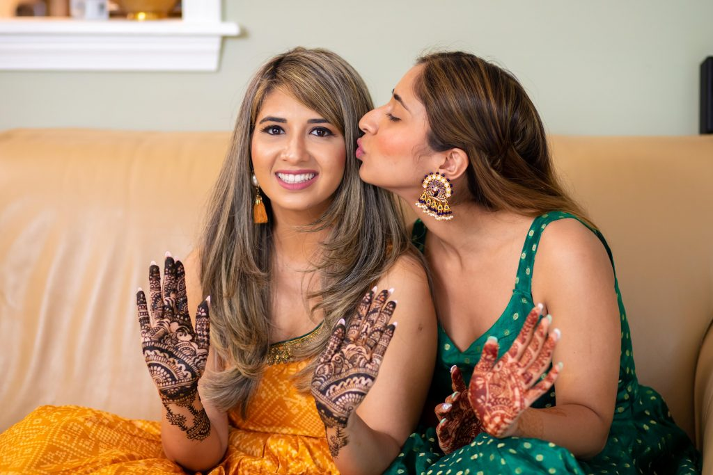 Vrunda with her sister at her intimate mehendi ceremony at home