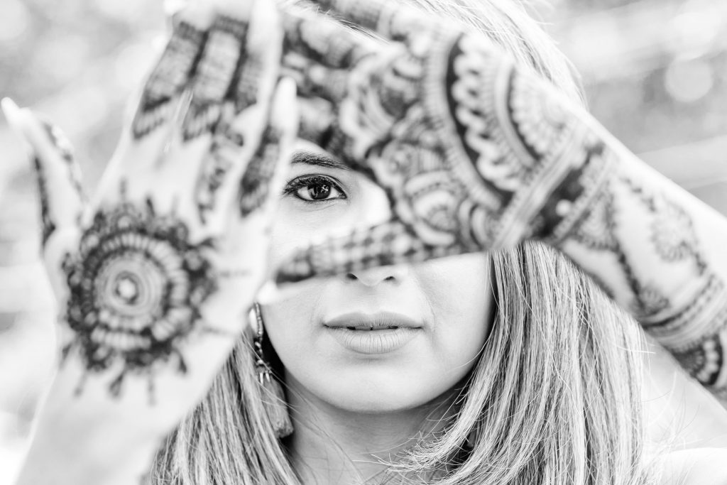 Black & white solo shot of Vrunda shoeing her hand Mehendi design