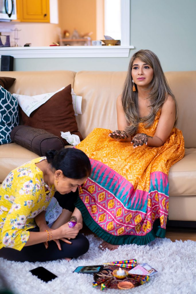 Vrunda getting her foot mehendi done at an intimate mehendi ceremony at home