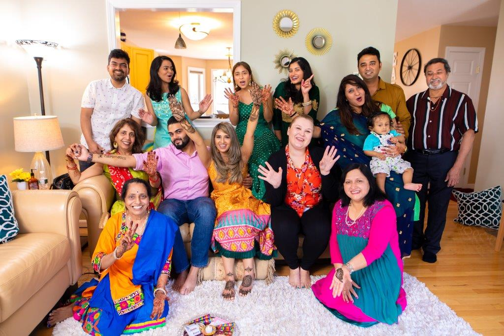 A cute family picture of Vrunda & Sunny's family at their intimate home wedding ceremony