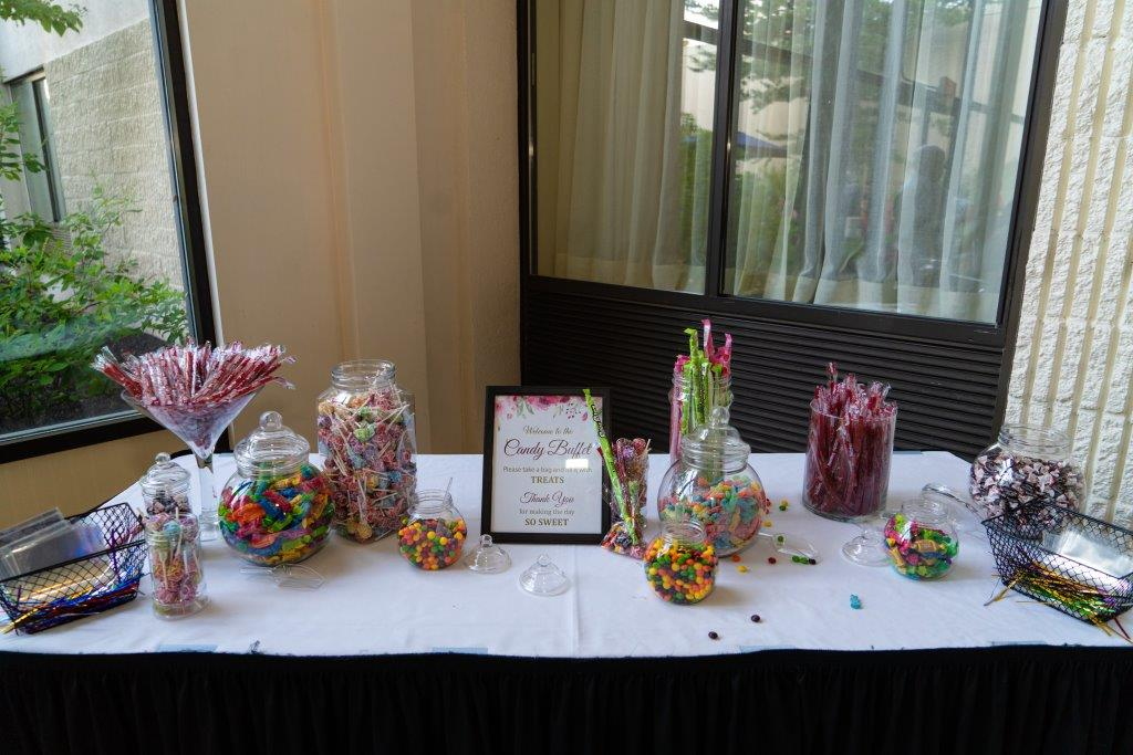 A cute candy bar setup at Vrunda & Sunny's Indoor forest themed wedding reception