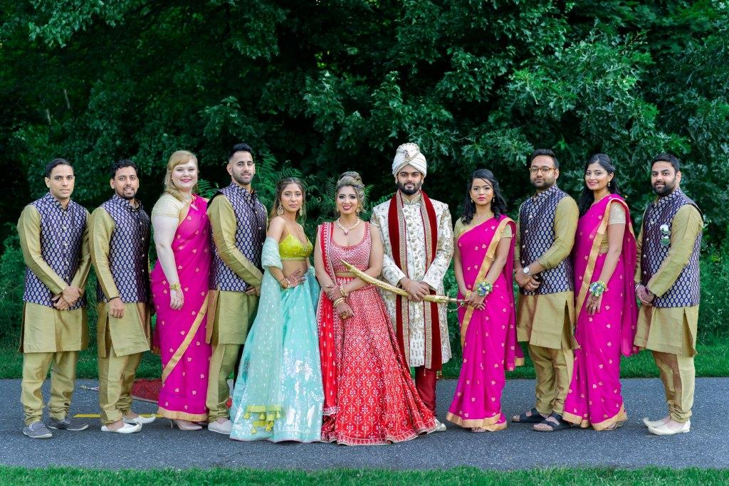 Vrunda & Sunny's picture with Bridesmaids & Groomsmen at their Indoor forest themed wedding