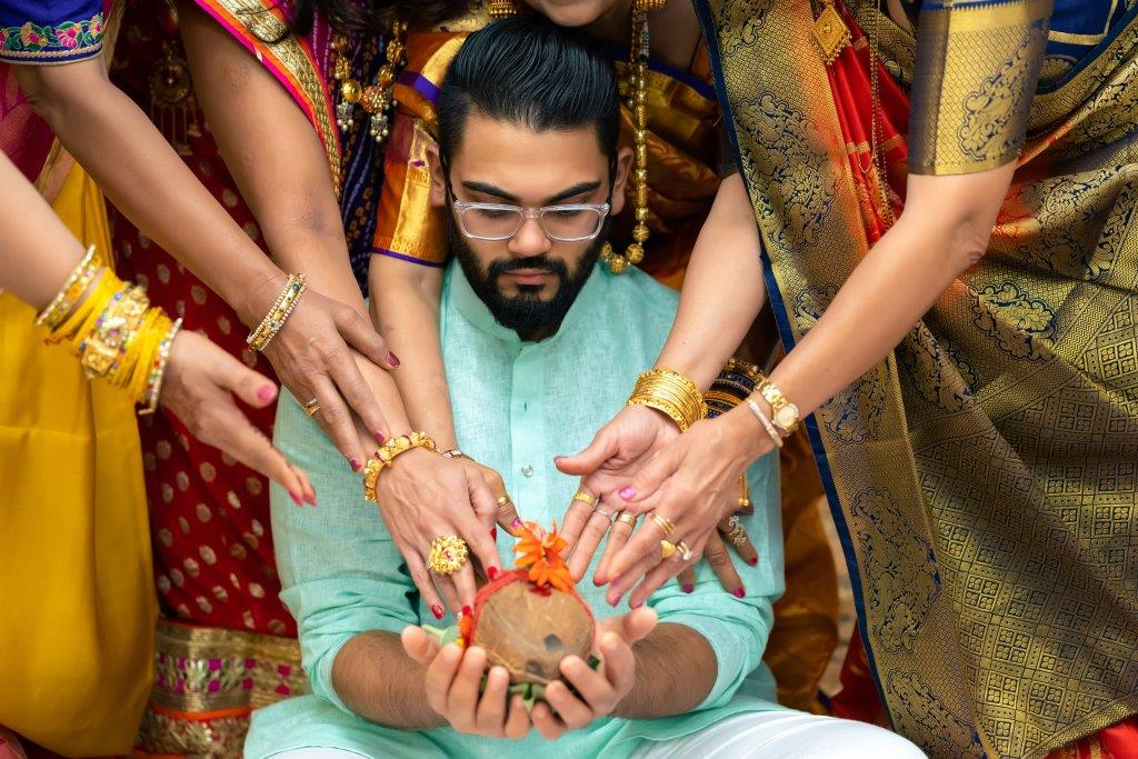 Sunny during the pre wedding rituals of his & Vrunda's forest themed wedding in Boston