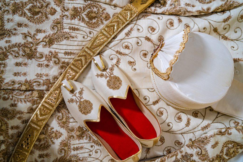 Picture of Sunny's wedding sherwani mojdi footwear & pagdi for his forest themed wedding in Boston