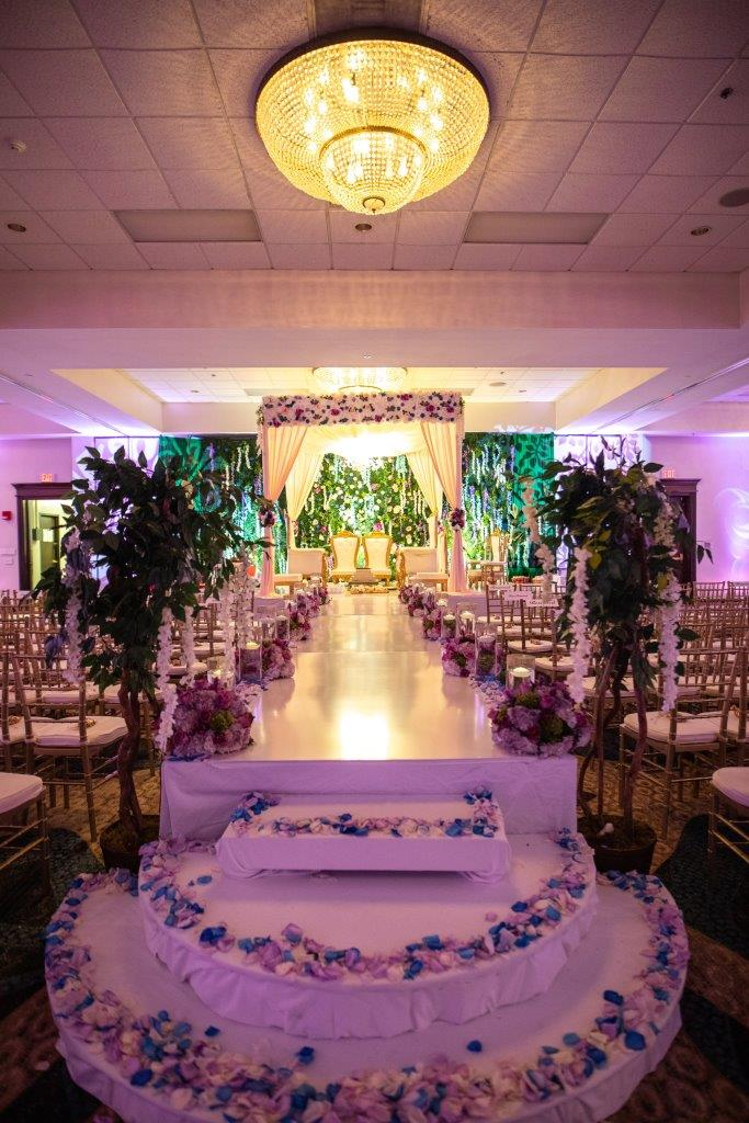 Indoor forest themed wedding setup for Vrunda & Sunny's wedding at the Doubletree by Hilton Boston