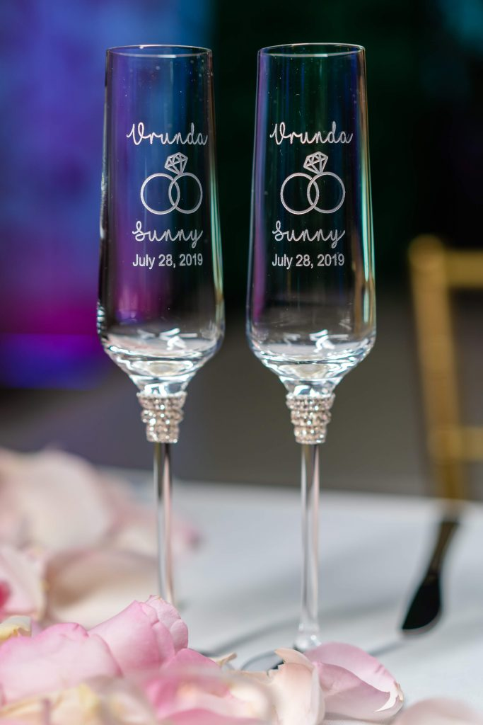Stamped wine glasses at the reception ceremony of Vrunda & Sunny