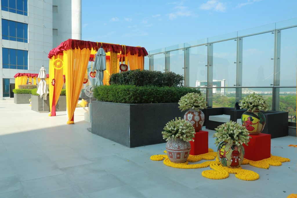 marwari mayra ceremony poolside with yellow marigold flowers and drapes