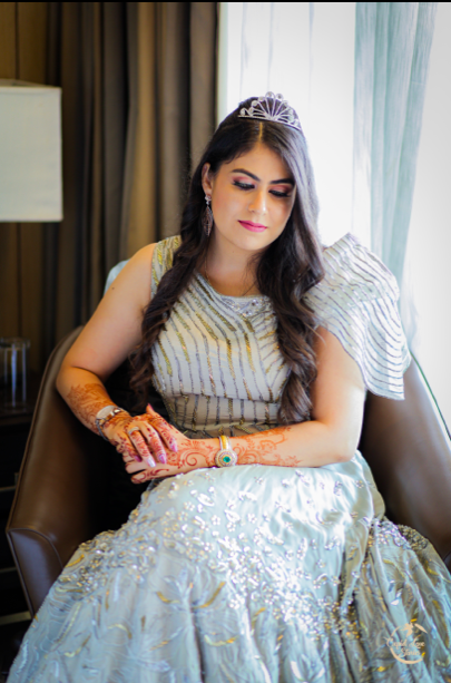Aparna glowing in her silver gown for her ring ceremony at JW Marriott Mussoorie