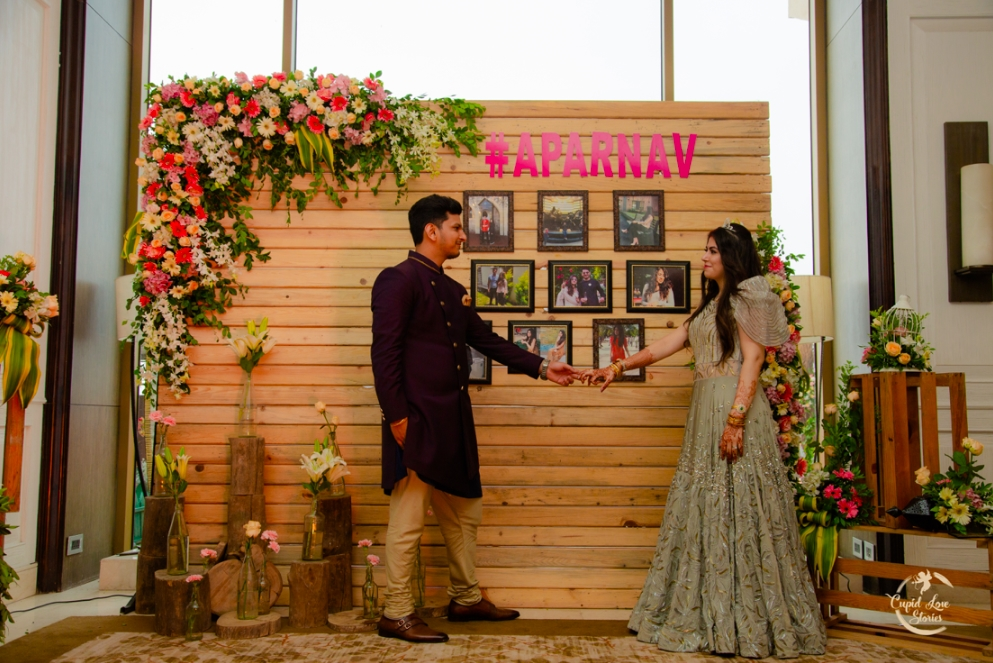 Beautiful Engagement Photo Booth Decor with the couple hashtag #Aparnav