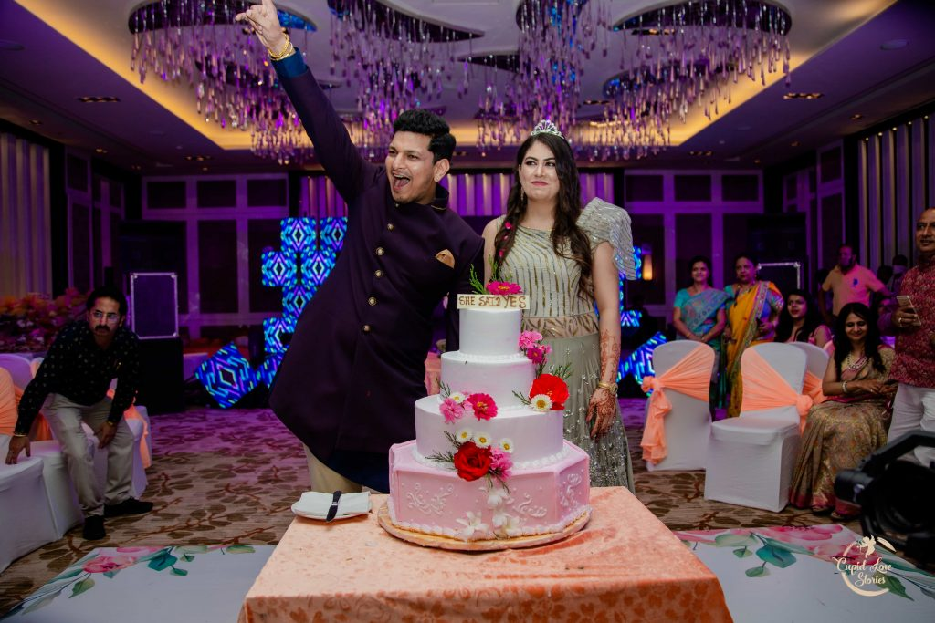 Cake Cutting at Aparna & Arnav's Ring Ceremony in jw marriott mussoorie ballroom