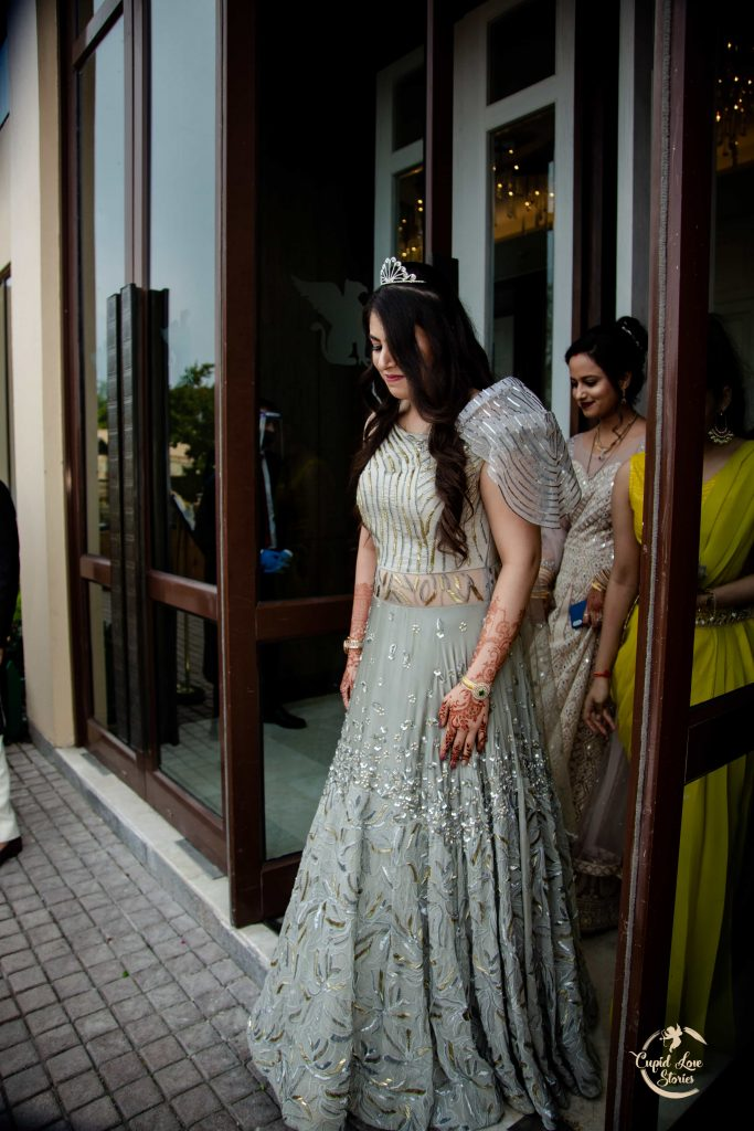 Aparna in a beautiful silver cocktail gown for her Modern and Contemporary Destination Engagement Party